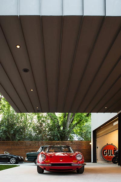 Autohaus is an unconventional residence in Austin, Texas designed by Matt Fajkus Architecture to showcase the owners' car collection
