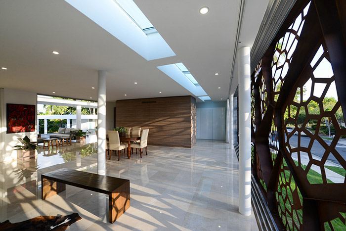 Award-winning Puerto Rican villa in San Juan with spectacular sculptural steel screen that makes for a breathtaking interior