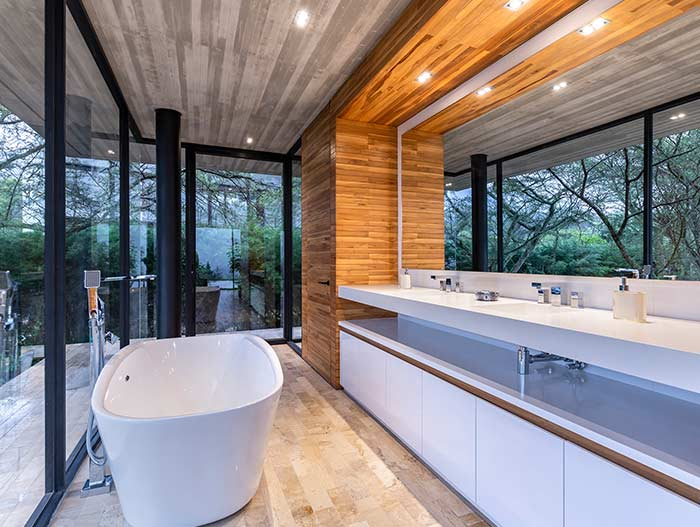Bathroom design idea in a spectacular single-family home in perfect balance with the surrounding environment - Tacuri House by Gabriel Rivera Arquitectos