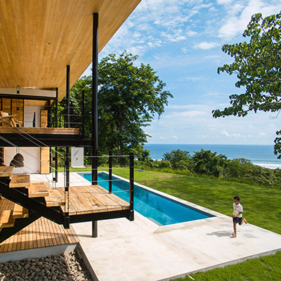 Wood is used throughout the interior of this eco-friendly house in Costa Rica with breathtaking views of the ocean and jungle - by Benjamin Garcia Saxe