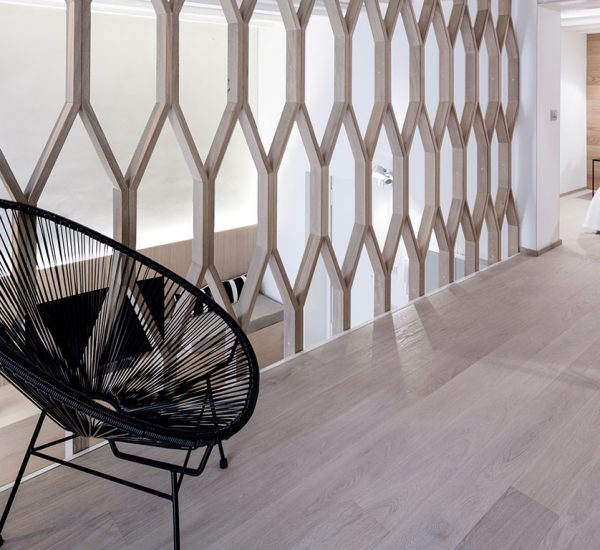 A dividing wall is used to separate rooms in this beautiful Italian apartment by Archiplan Studio