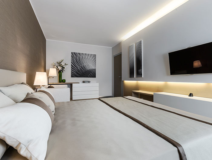 Modern bedroom in spectacular apartment for a relaxing and lavish lifestyle on the French Riviera