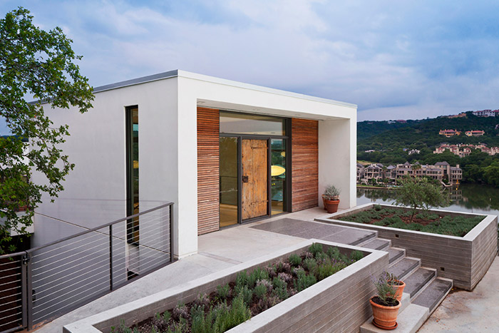Bold modern entry to unconventional cliff dwelling near lake Austin, Texas