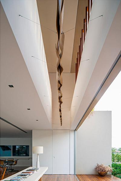 Casa TM by Studio Arthur Casas with unique furniture pieces and beautiful interior design