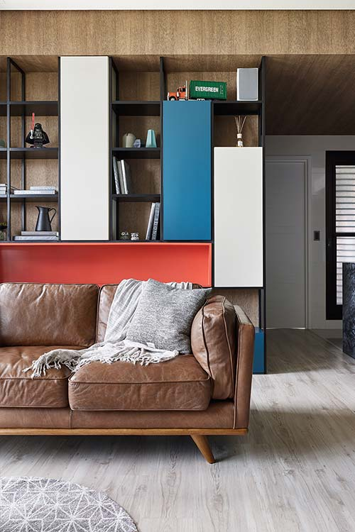 Colorful furniture makes this small living area feel modern