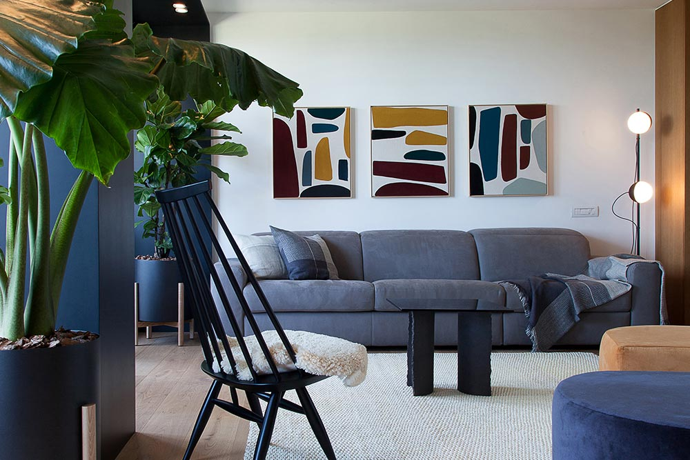 Add color and character to your monochromatic living room through artwork and photography