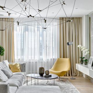 Comfortable Moscow apartment with colorful furniture and playful textures exudes sophistication