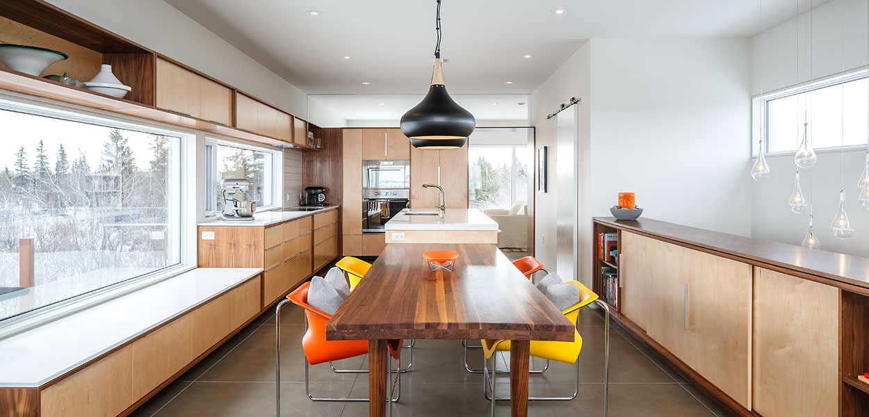 Beautiful open-space kitchen and dining area in a contemporary three-storey house in Canada by Omar Gandhi Architect