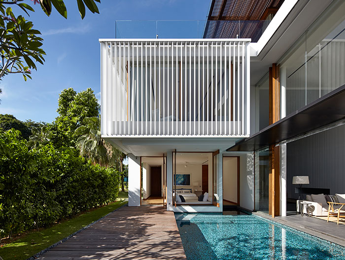 Contemporary Sentosa Cove holiday retreat for a Chinese family, designed by Robert Greg Shand Architects