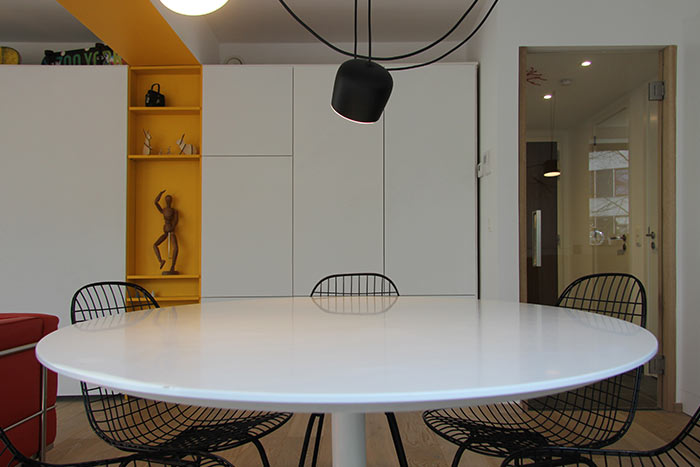 Dining area design idea in a stylish apartment located in Brussels, Belgium