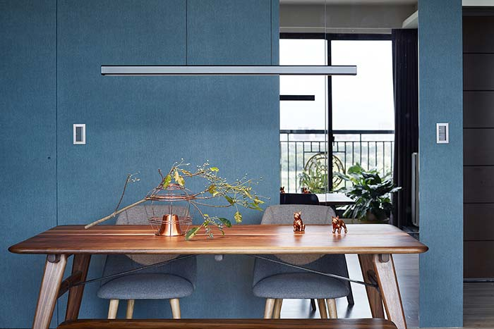 Modern dining area inside a small home in New Taipei City, Taiwan designed by Awork.Design Studio