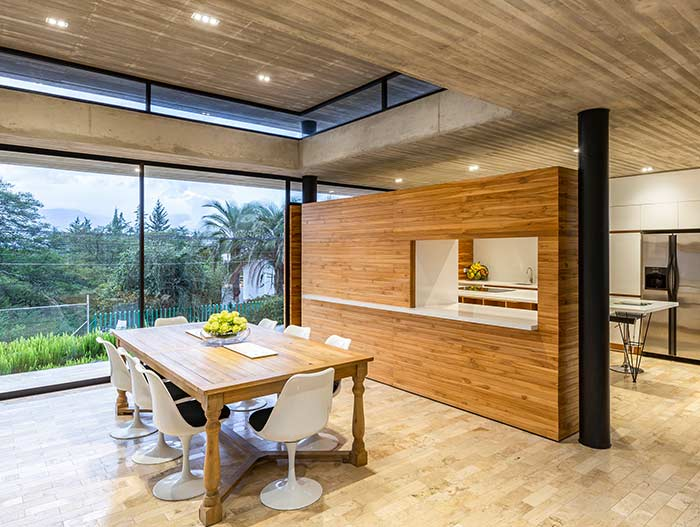 Dining room design idea in a spectacular single-family home in perfect balance with the surrounding environment - Tacuri House by Gabriel Rivera Arquitectos