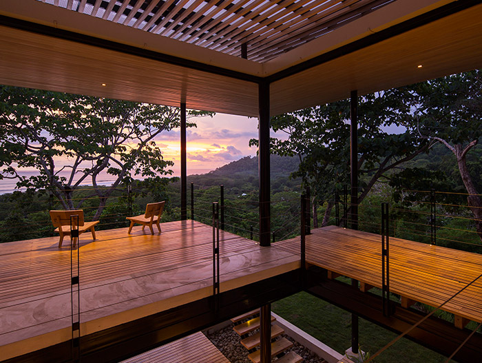 Relaxing terrace of a beautiful, eco-friendly house in Costa Rica with stunning pool and breathtaking views