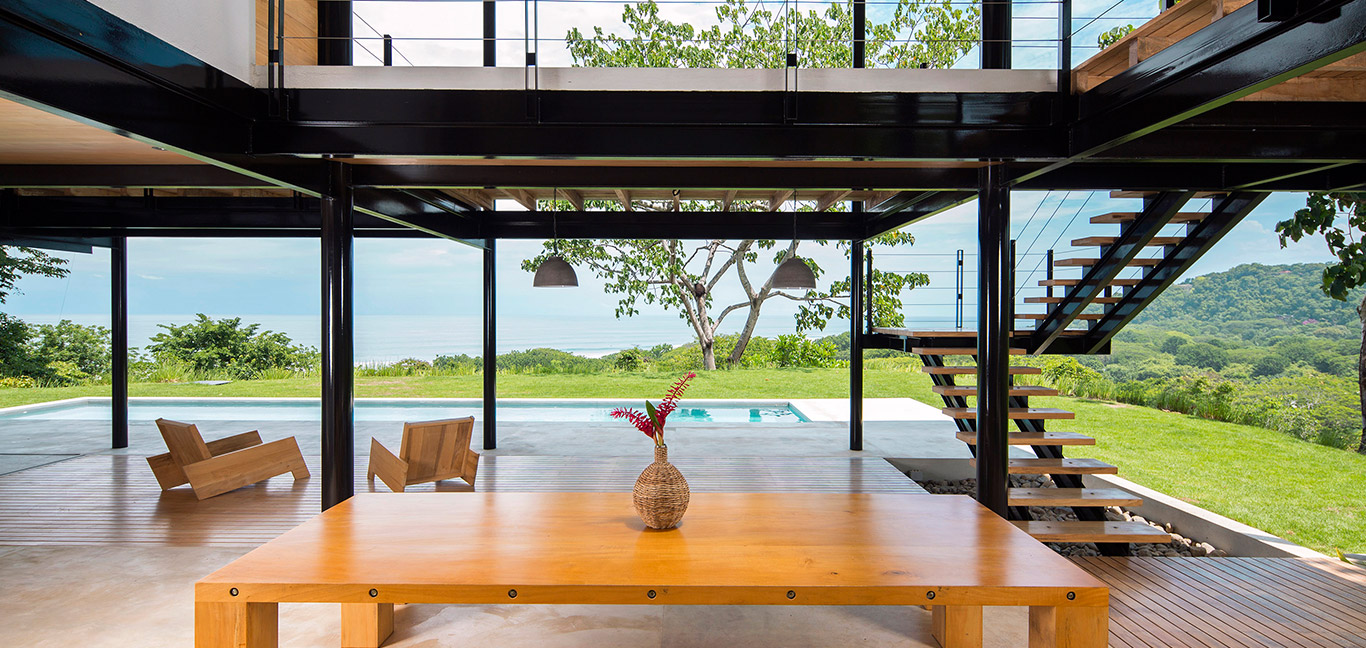 Wood is used throughout the interior of this eco-friendly house in Costa Rica with breathtaking views of the ocean - design by Benjamin Garcia Saxe