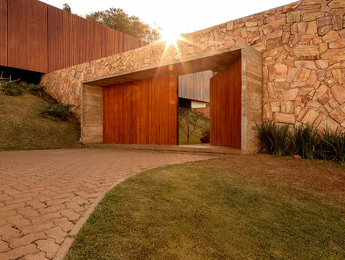 House of Stones by mf+arquitetos located in Brazil - entry door to the beautiful Brazilian house