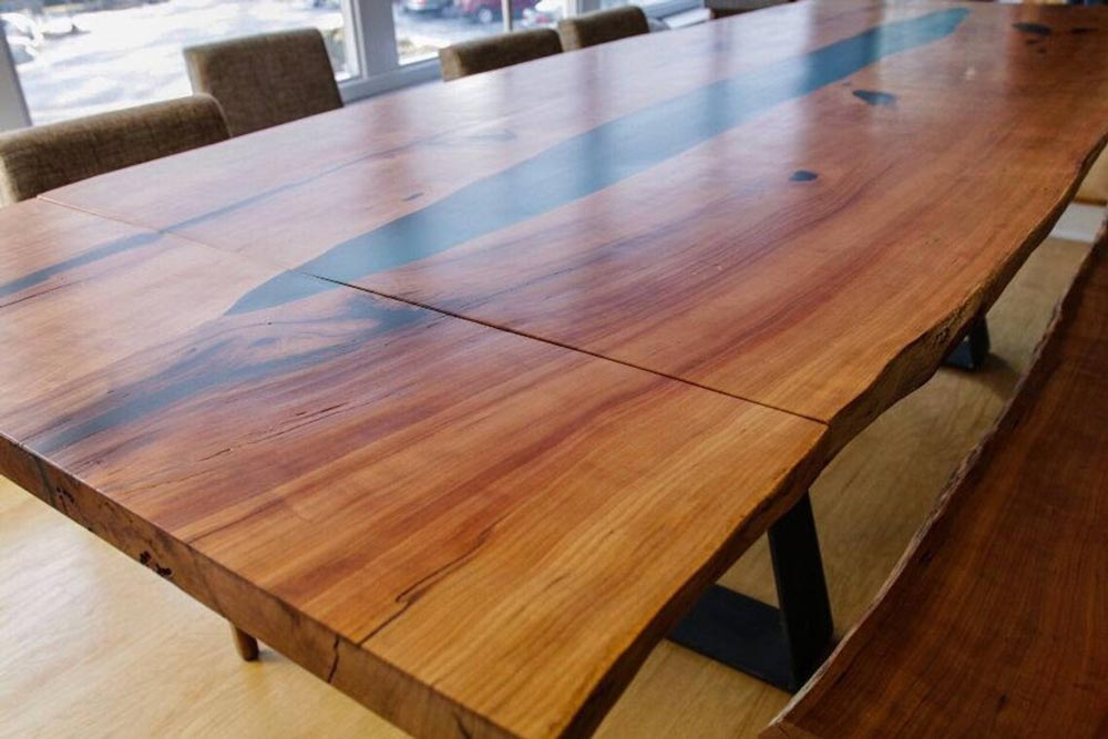 Extendable epoxy dining table