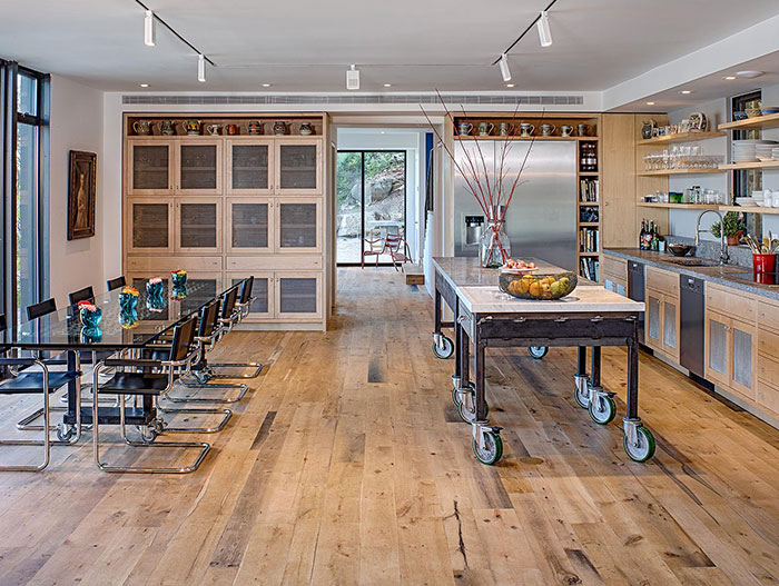 Industrial looking kitchen and dining area in modern house near lake Austin, Texas