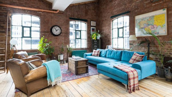 Industrial penthouse located in Shoreditch, London features exposed brick walls and copper elements