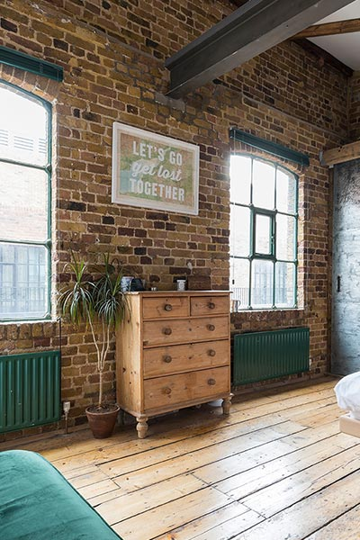 Industrial penthouse in Shoreditch, London features exposed brick walls and copper elements