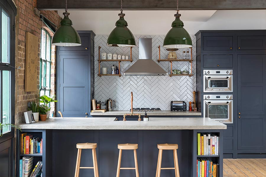 Industrial kitchen design idea in a renovated penthouse located in London