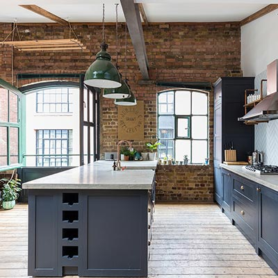 Industrial kitchen design idea in a renovated London penthouse