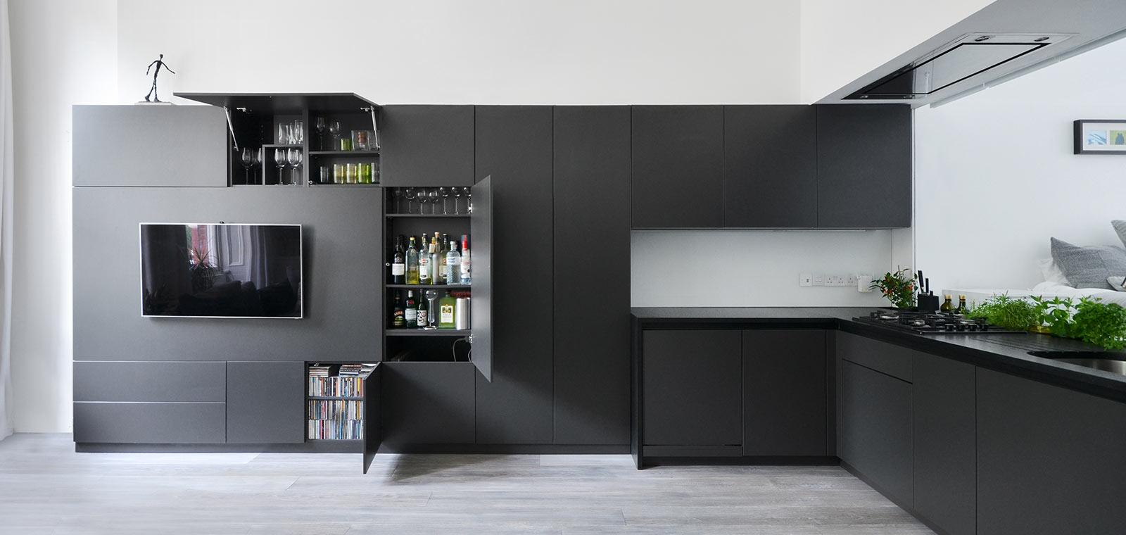 Black kitchen with hidden storage - Renovation by DPAW