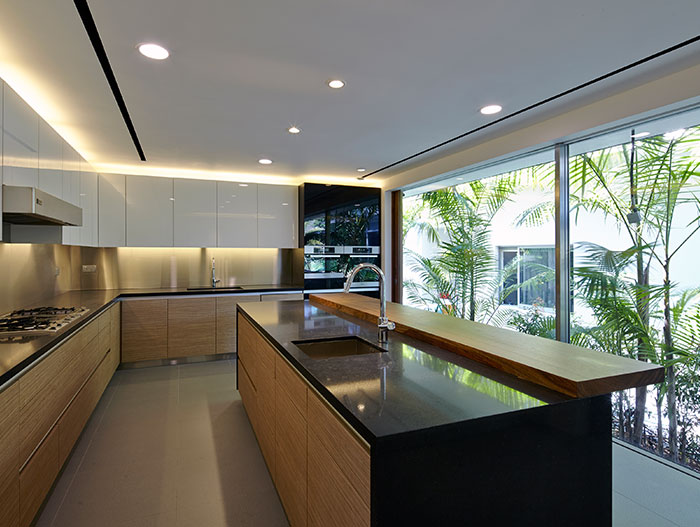 Modern kitchen in Sentosa Cove holiday retreat for a family living by the sea