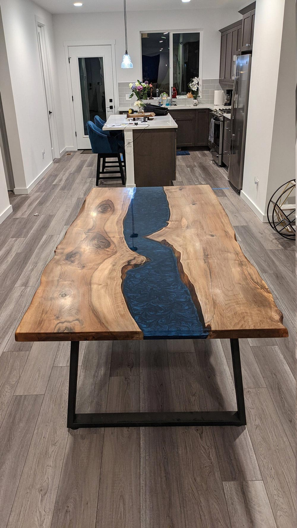 Live Edge Epoxy Dining Table - made of walnut wood and epoxy resin
