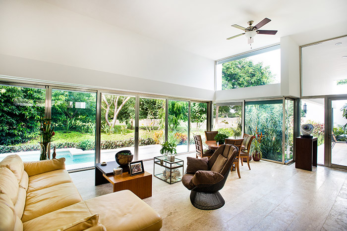 Large living room overlooking lush garden in award-winning house in Yucatan, Mexico