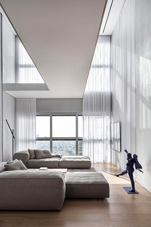 Cozy living area in a bright duplex apartment in Tel Aviv, Israel