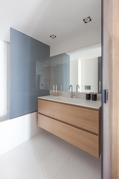 Suspended oak sink in a small bathroom - renovated one-bedroom home in Barcelona, Spain by YLAB Arquitectos