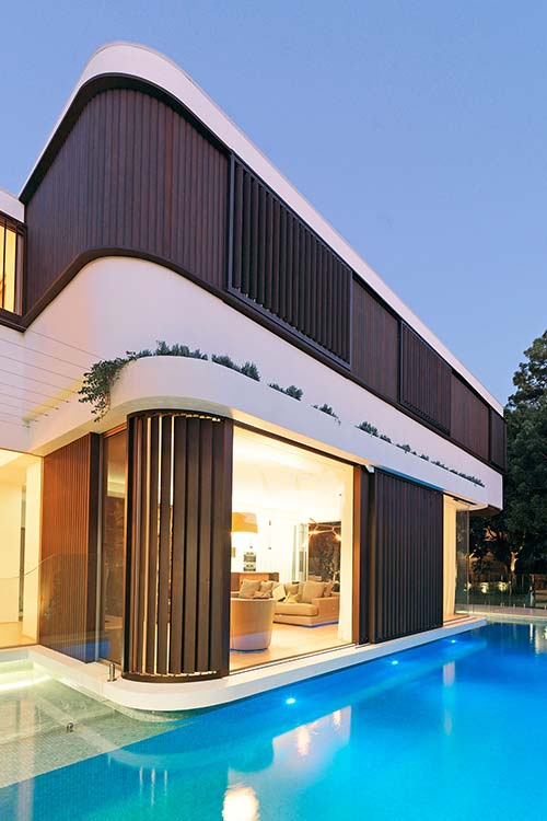 Two-storey addition in Australia surrounded by a swimming pool