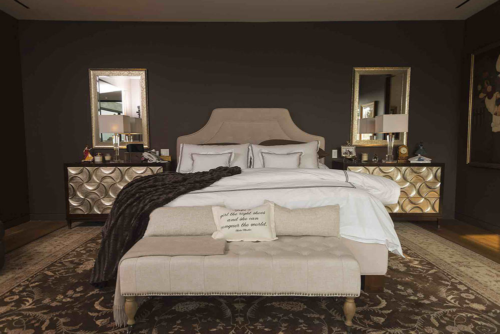 Luxurious bedroom design with dark paint wall and expensive furniture
