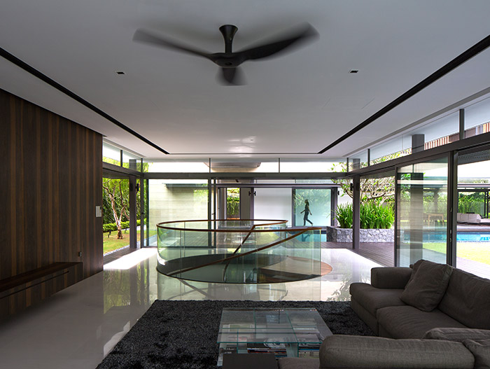 Secret Garden House: Amazing living room design idea with spiral staircase in a luxurious, contemporary home in Singapore by Wallflower Architecture + Design