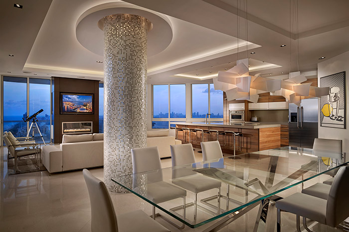 Luxurious kitchen, dining and living area in a breathtaking penthouse in Miami Beach by Pepe Calderin Design