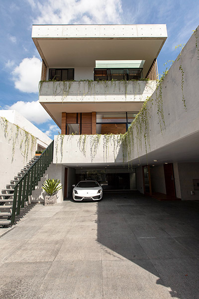 Luxury house with luxury Lamborghini parked outside - East Singapore designed by Aamer Architects