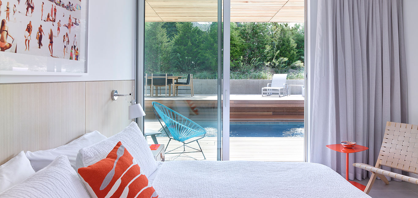 Mako Residence: Colorful master bedroom in multigenerational house in New York