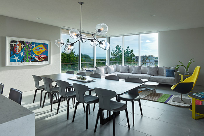 Open space kitchen, dining and living area inside multigenerational house in New York