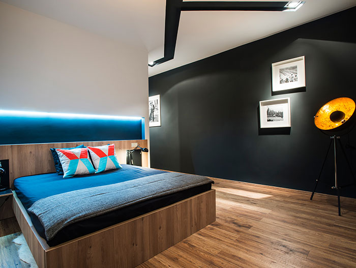 LED light and colorful contemporary master bedroom in Budapest apartment