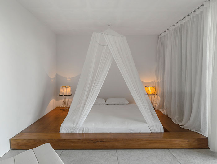 Minimalist white bedroom design with amazing bed in Brazil