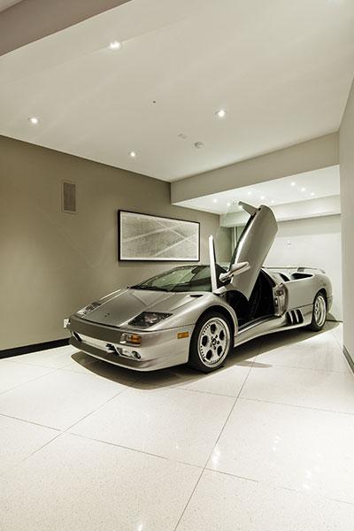 Modern Hollywood bachelor pad with Lamborghini near living room
