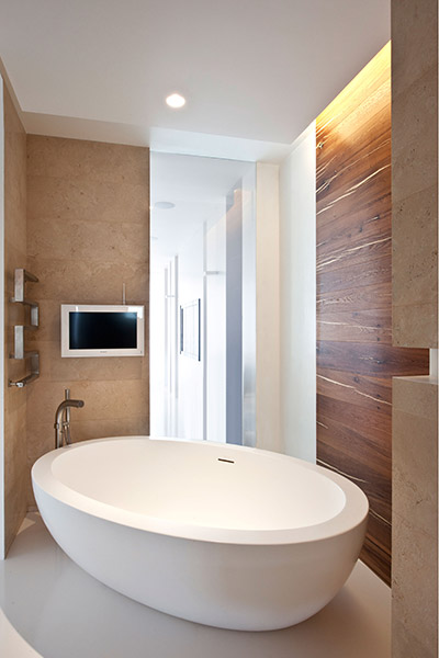 Modern bathroom with TV in all white apartment Moscow