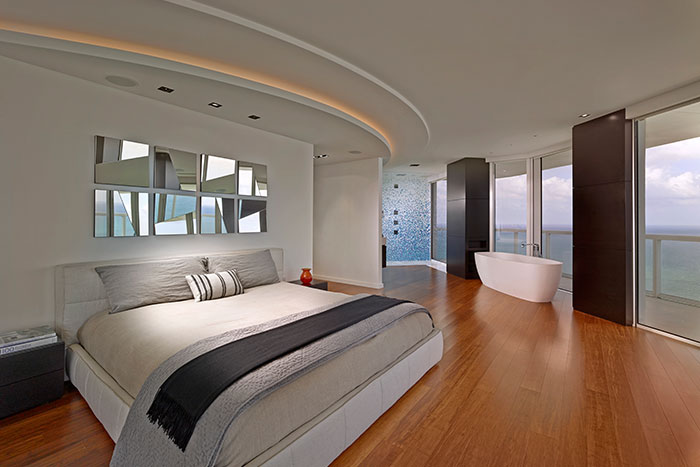 Modern bedroom in a breathtaking penthouse in Miami Beach, Florida by Pepe Calderin Design