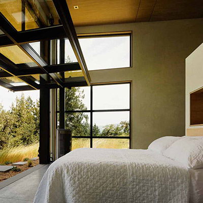 Modern California home with massive glass walls which allows master bedroom to open up to the spectacular surroundings