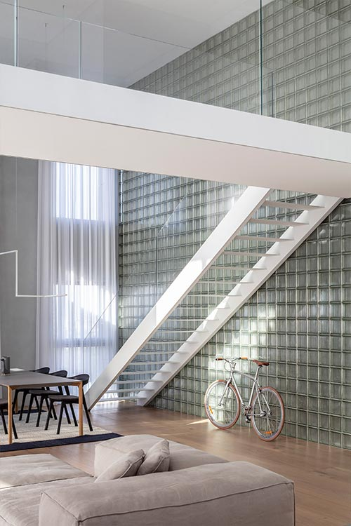 Bright duplex in Israel features a glass block wall