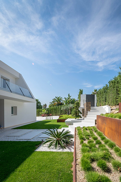 Backyard and garden of modern residence near Barcelona, Spain designed by 08023 Architects which renovated an old residence