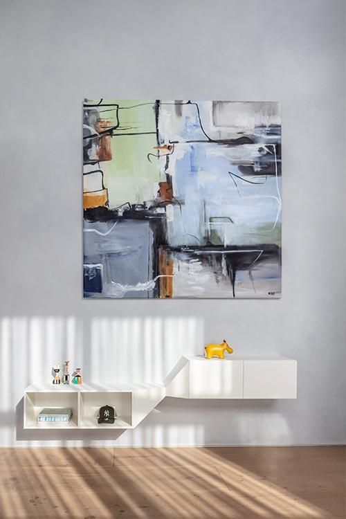 Modern white furniture in a Tel Aviv duplex apartment