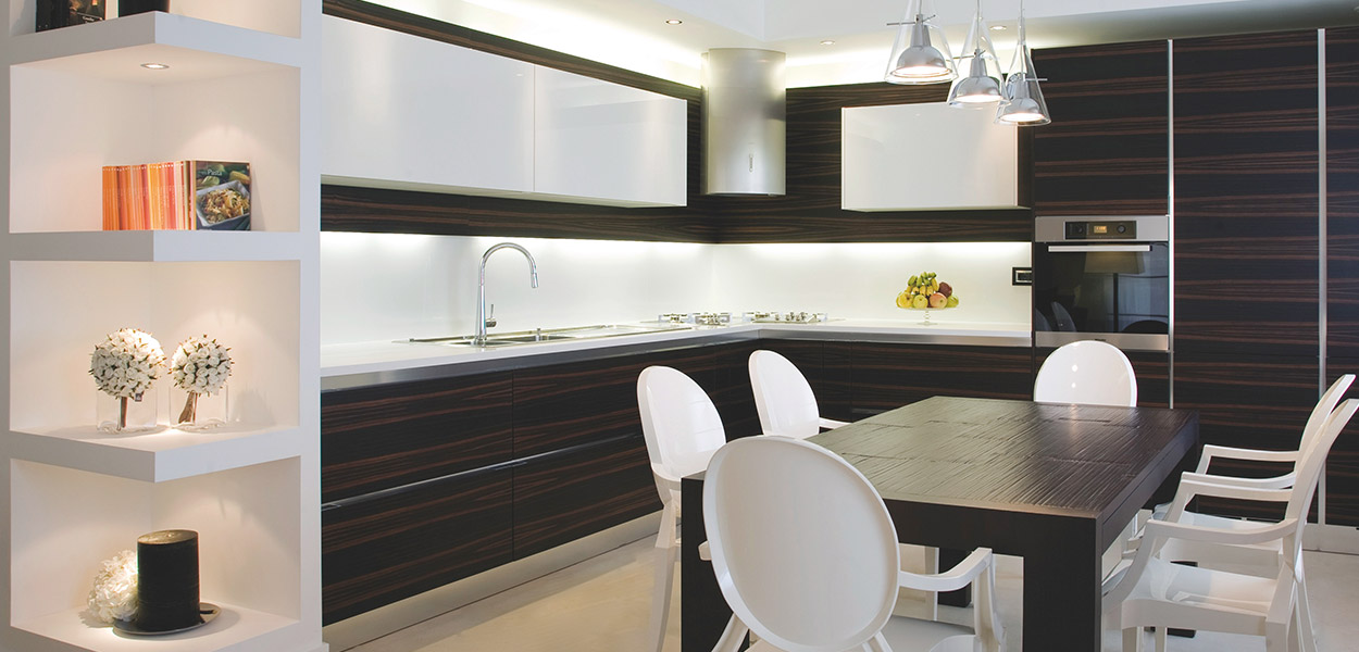 Modern kitchen and dining area in remodeled duplex apartment in Benevento, Italy by interior designer Ernesto Fusco