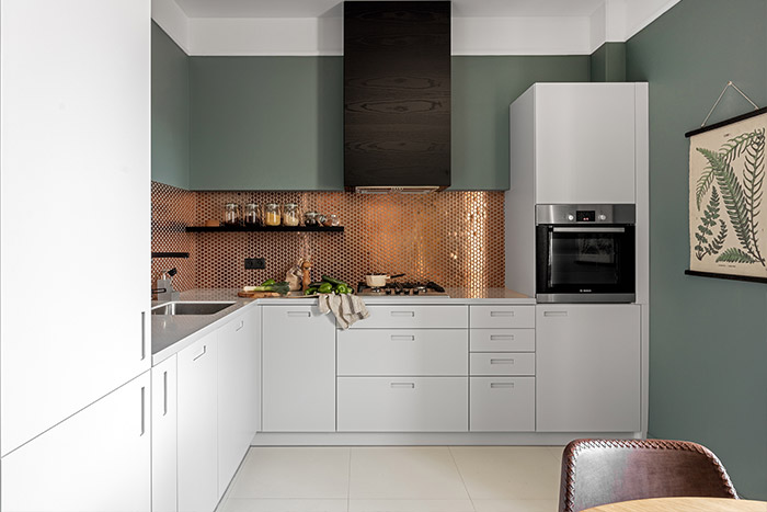 Stylish dark toned modern kitchen design idea from small apartment renovation in Warsaw, Poland by Finchstudio