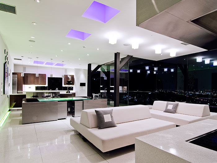 Modern living dining area in bachelor pad Harold Way Residence
